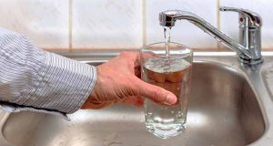 Tap drinking water pouring into glass